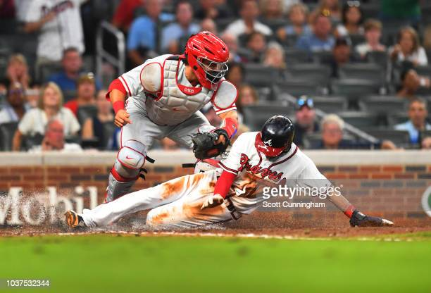 Dansby Swanson of the Atlanta Braves is tagged out a home during the seventh inning by Wilson Ramos of the Philadelphia Phillies at SunTrust Park on...