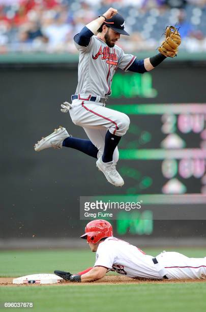 Dansby Swanson of the Atlanta Braves jumps over Trea Turner of the Washington Nationals in the first inning at Nationals Park on June 14 2017 in...