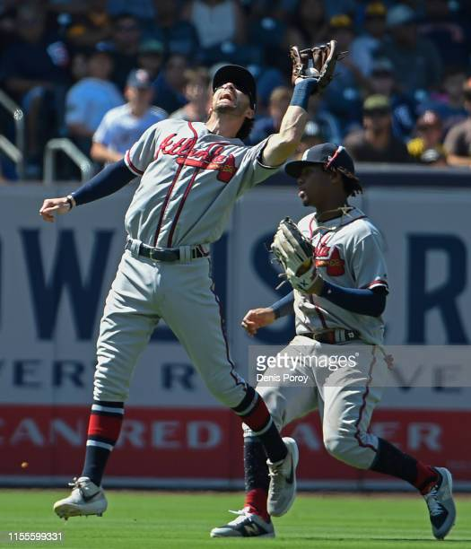 Dansby Swanson of the Atlanta Braves makes the catch on a ball hit by Greg Garcia of the San Diego Padres during the seventh inning of a baseball...