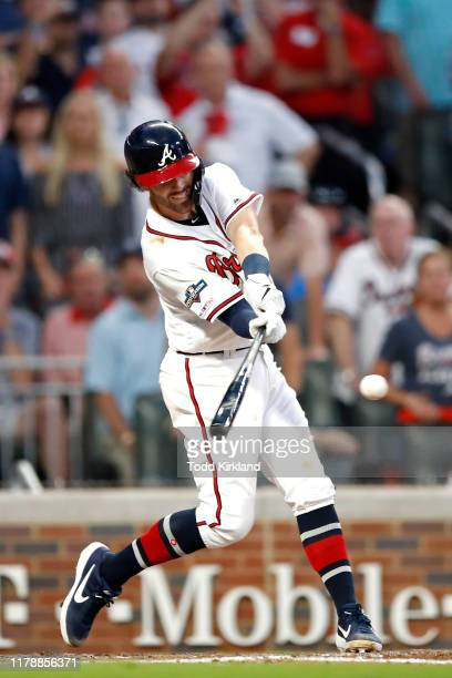 Dansby Swanson of the Atlanta Braves reaches first base on a fielders choice and an error as two runs score against the St Louis Cardinals during the...