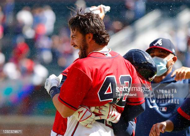 Dansby Swanson of the Atlanta Braves reacts after his game winning single in the ninth inning of an MLB game against the Miami Marlins at Truist Park...