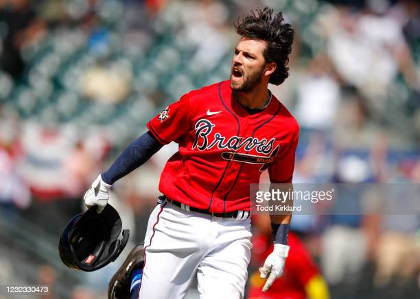 Dansby Swanson of the Atlanta Braves reacts after hitting a walk off, game winning single in the ninth inning of an MLB game against the Miami...
