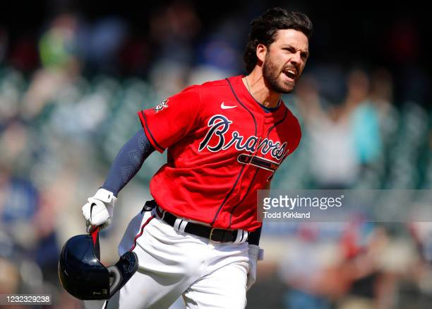 Dansby Swanson of the Atlanta Braves reacts after hitting the walk off, game winning single in the ninth inning of an MLB game against the Miami...