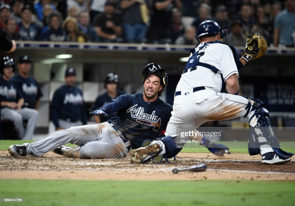 Dansby Swanson #7 of the Atlanta Braves scores ahead of the tag of A.J. Ellis #17 of the San Diego Padres during the seventh inning of a baseball game at PETCO Park on June 5, 2018 in San Diego, California.