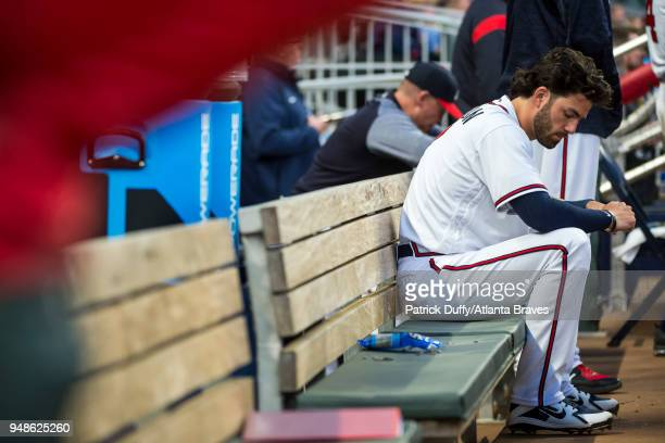 Dansby Swanson of the Atlanta Braves sits in the dugout during the game against the Philadelphia Phillies at SunTrust Park on March 30 in Atlanta...