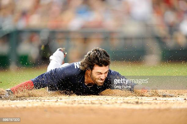 Dansby Swanson of the Atlanta Braves slides into home plate with an insidethepark home run for his first career home run in the second inning against...