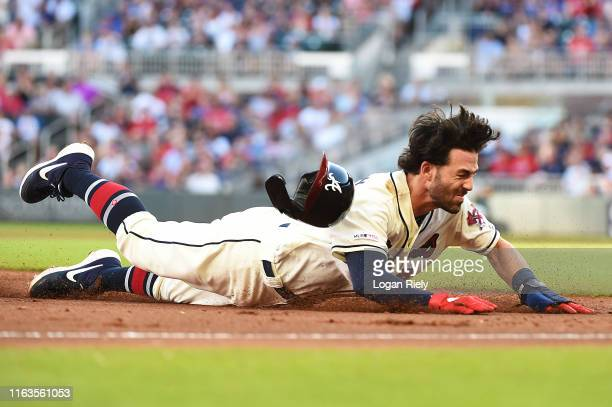 Dansby Swanson of the Atlanta Braves slides safely into third base against the Washington Nationals at SunTrust Park on July 21 2019 in Atlanta...