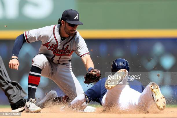 Dansby Swanson of the Atlanta Braves tags out Orlando Arcia of the Milwaukee Brewers during a stolen base attempt in the fifth inning at Miller Park...