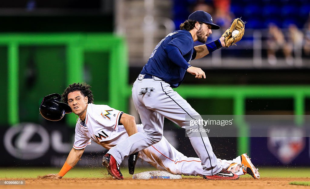 Dansby Swanson #2 of the Atlanta Braves tags out Yefri Perez #77 of the Miami Marlins attempting to steal second base during the ninth inning of the game at Marlins Park on September 23, 2016 in Miami, Florida.