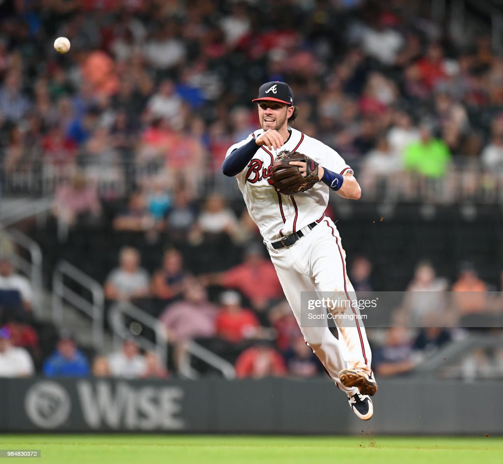 Dansby Swanson #7 of the Atlanta Braves throws out a sixth inning runner against the Cincinnati Reds at SunTrust Park on June 26, 2018 in Atlanta, Georgia.