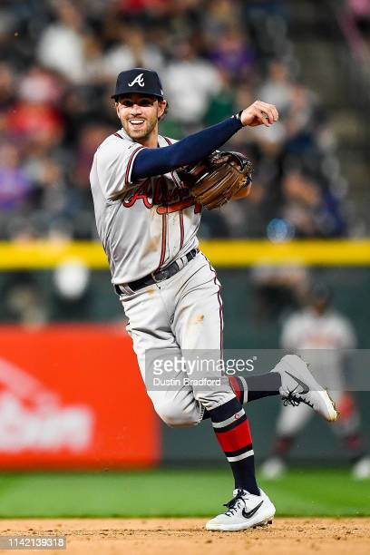 Dansby Swanson of the Atlanta Braves throws to complete a seventh inning double play at Coors Field on April 8 2019 in Denver Colorado