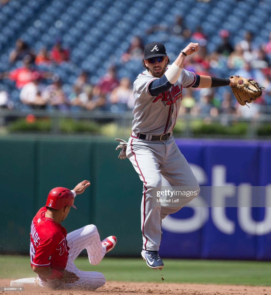 Dansby Swanson #7 of the Atlanta Braves turns a double play against Cesar Hernandez #16 of the Philadelphia Phillies in the bottom of the eighth inning in game one of the doubleheader at Citizens Bank Park on August 30, 2017 in Philadelphia, Pennsylvania. The Braves defeated the Phillies 9-1.
