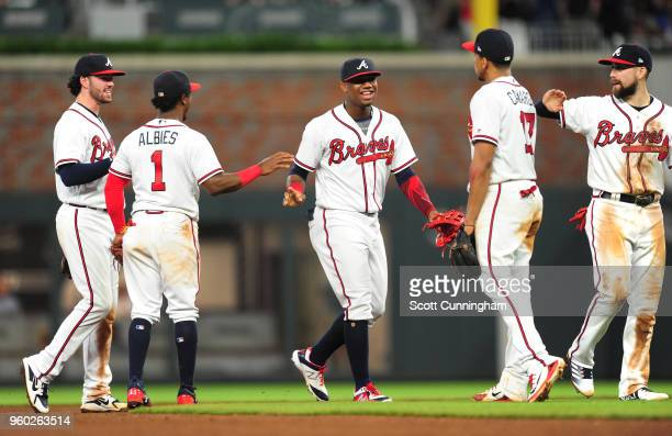 Dansby Swanson Ozzie Albies Ronald Acuna Jr #13 Johan Camargo and Ender Inciarte of the Atlanta Braves celebra after the game against the Miami...