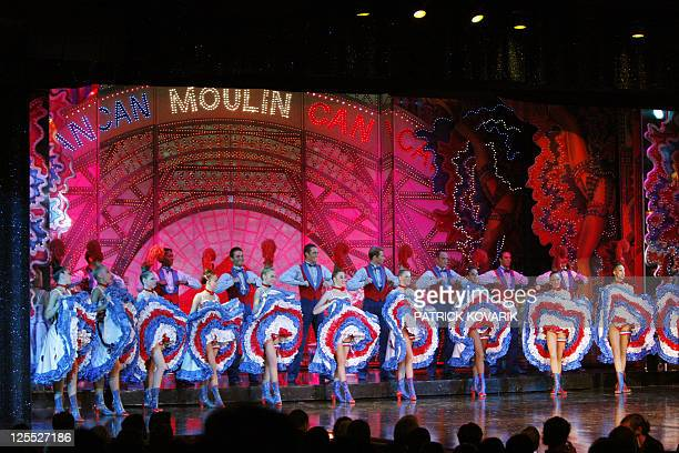 Dansers perform on stage on September 17 2009 at the Moulin Rouge Cabaret in Paris The Moulin Rouge created by Joseph Oller and Charles Zidler in...