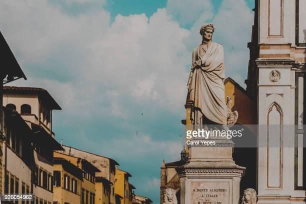 dante alighighieri statue in florence - dante alighieri foto e immagini stock