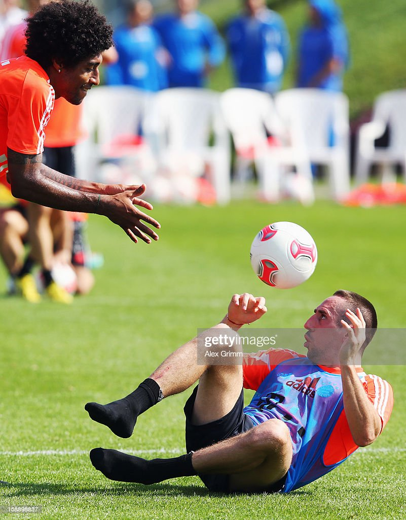 Dante (L) and Franck Ribery exercise during a Bayern Muenchen training session at the ASPIRE Academy for Sports Excellence on January 3, 2013 in Doha, Qatar.
