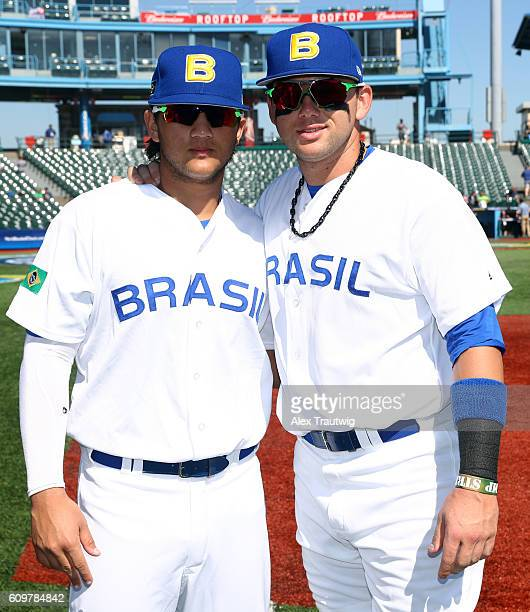 Dante Bichette Jr #19 and Bo Bichette pose for a photo prior to Game 1 of the 2016 World Baseball Classic Qualifier at MCU Park on Thursday September...