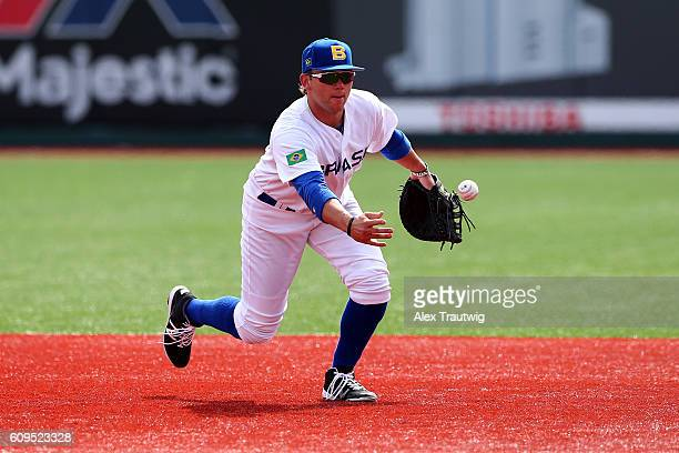 Dante Bichette Jr #19 of Team Brazil fields a ball during workouts at MCU Park prior to the start of the 2016 World Baseball Classic Qualifier on...
