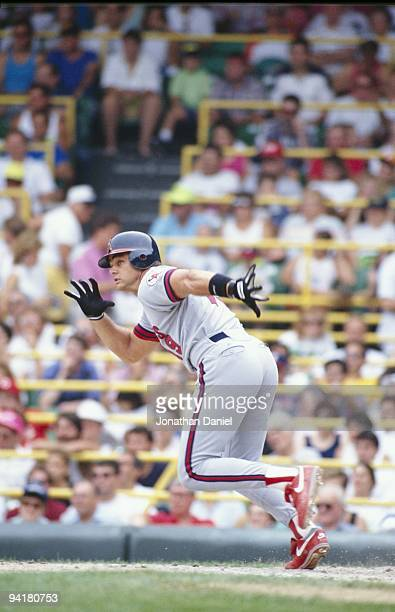 Dante Bichette of the California Angels runs to first during a game in the 1990 season