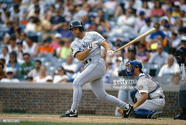 Dante Bichette of the Colorado Rockies bats against the Chicago Cubs during an Major League Baseball game circa 1994 at Wrigley Fields in Chicago...