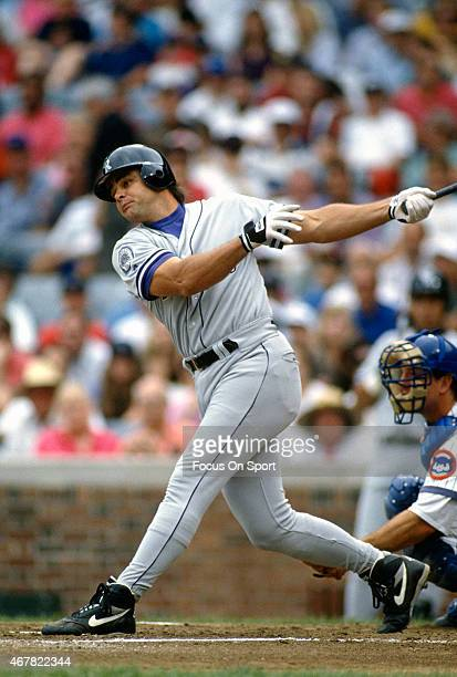 Dante Bichette of the Colorado Rockies bats against the Chicago Cubs during an Major League Baseball game circa 1993 at Wrigley Fields in Chicago...