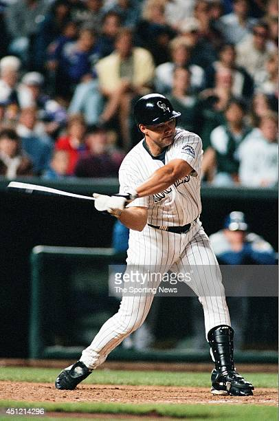 Dante Bichette of the Colorado Rockies bats against the Los Angeles Dodgers at Coors Field on September 16, 1996 in Denver, Colorado.