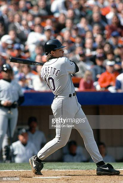 Dante Bichette of the Colorado Rockies bats against the New York Mets during an Major League Baseball game circa 1993 at Shea Stadium in the Queens...