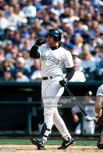 Dante Bichette of the Colorado Rockies bats during an Major League Baseball game circa 1995 at Coors Field in Denver, Colorado. Bichette played for...