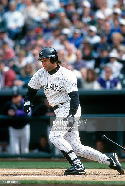 Dante Bichette of the Colorado Rockies bats during an Major League Baseball game circa 1995 at Coors Field in Denver Colorado Bichette played for the...