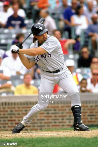 Dante Bichette of the Colorado Rockies bats during an MLB game at Wrigley Field in Chicago, Illinois. Bichette played for 17 years with 5 different...