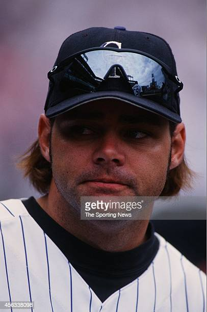 Dante Bichette of the Colorado Rockies looks on against the Montreal Expos at Coors Field on August 15 1999 in Denver Colorado