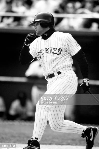 Dante Bichette of the Colorado Rockies swings at the pitch during an MLB game circa 1995 at Coors Field in Denver Colorado