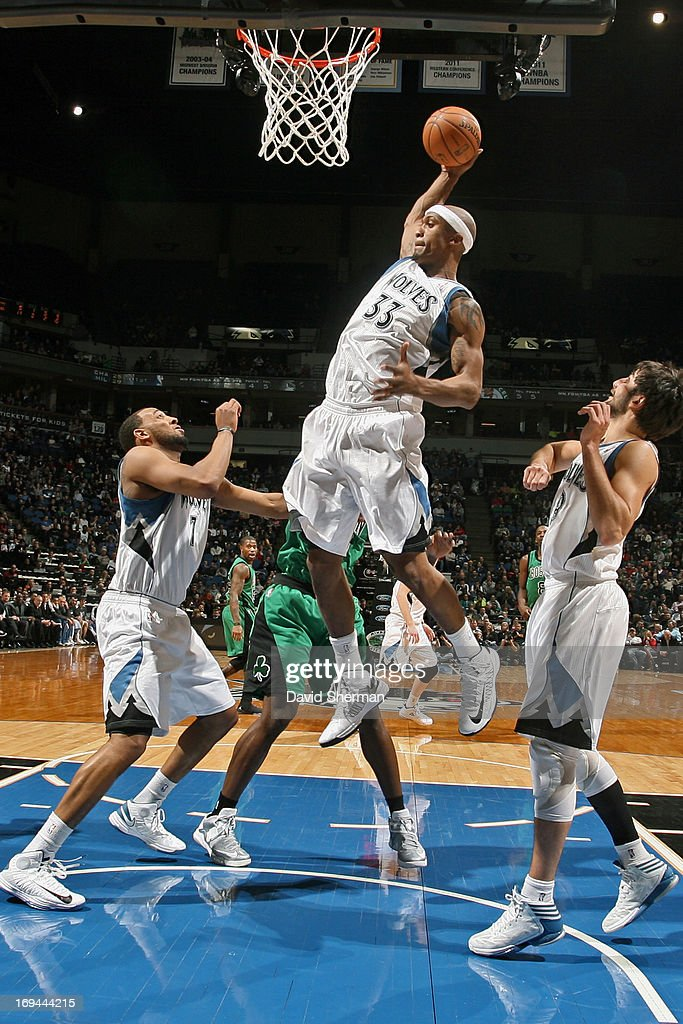 Dante Cunningham #33 of the Minnesota Timberwolves comes down with the rebound against the Boston Celtics during the game on April 1, 2013 at Target Center in Minneapolis, Minnesota.