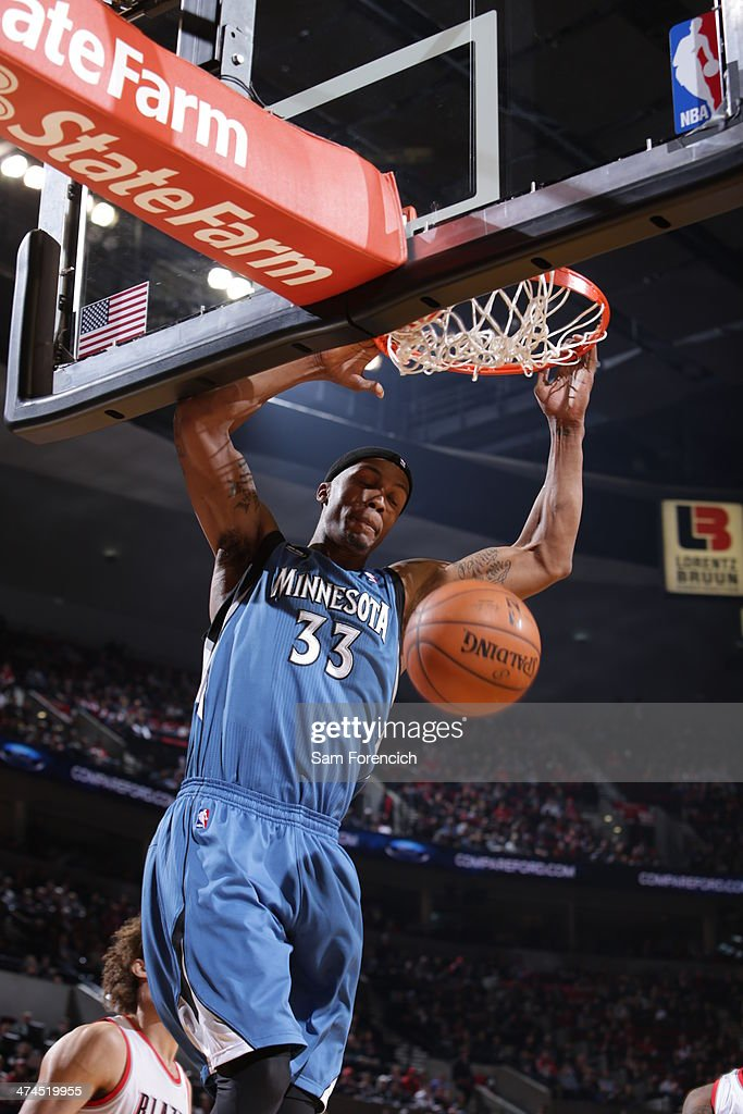 Dante Cunningham #33 of the Minnesota Timberwolves dunks during a game against the Portland Trail Blazers on February 23, 2014 at the Moda Center Arena in Portland, Oregon.