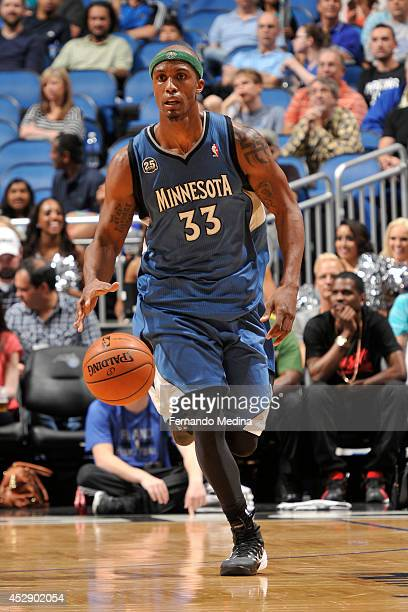 Dante Cunningham of the Minnesota Timberwolves handles the ball against the Orlando Magic on April 5 2014 at Amway Center in Orlando Florida NOTE TO...