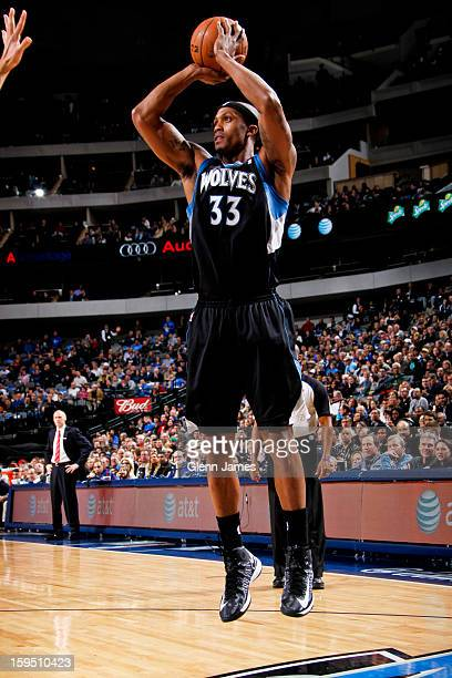 Dante Cunningham of the Minnesota Timberwolves shoots against the Dallas Mavericks on January 14 2013 at the American Airlines Center in Dallas Texas...
