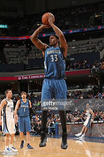 Dante Cunningham of the Minnesota Timberwolves shoots against the Memphis Grizzlies on March 24 2014 at FedExForum in Memphis Tennessee NOTE TO USER...