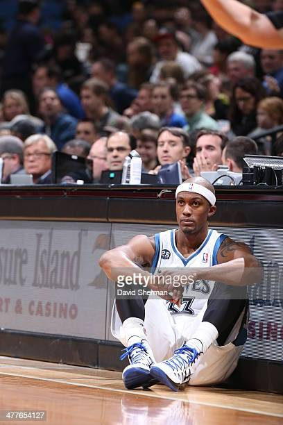 Dante Cunningham of the Minnesota Timberwolves waits to get into the game against the Detroit Pistons on March 7 2014 at Target Center in Minneapolis...