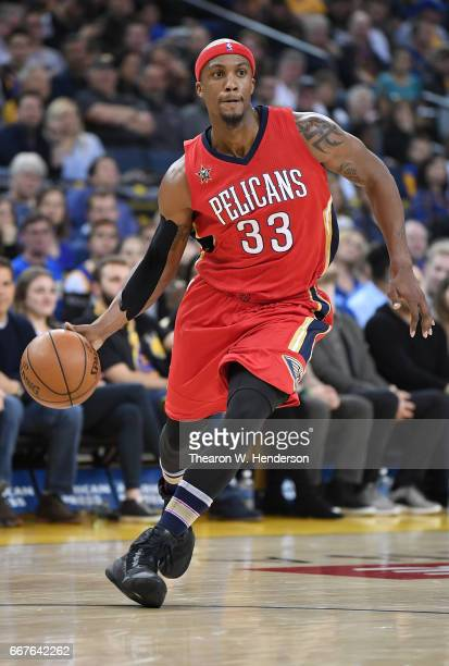 Dante Cunningham of the New Orleans Pelicans dribbles the ball on offense against the Golden State Warriors during an NBA Basketball game at ORACLE...