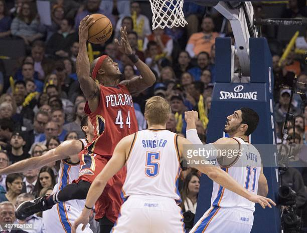 Dante Cunningham of the New Orleans Pelicans goes between Oklahoma City Thunder players for a two point shot during the second quarter of a NBA game...