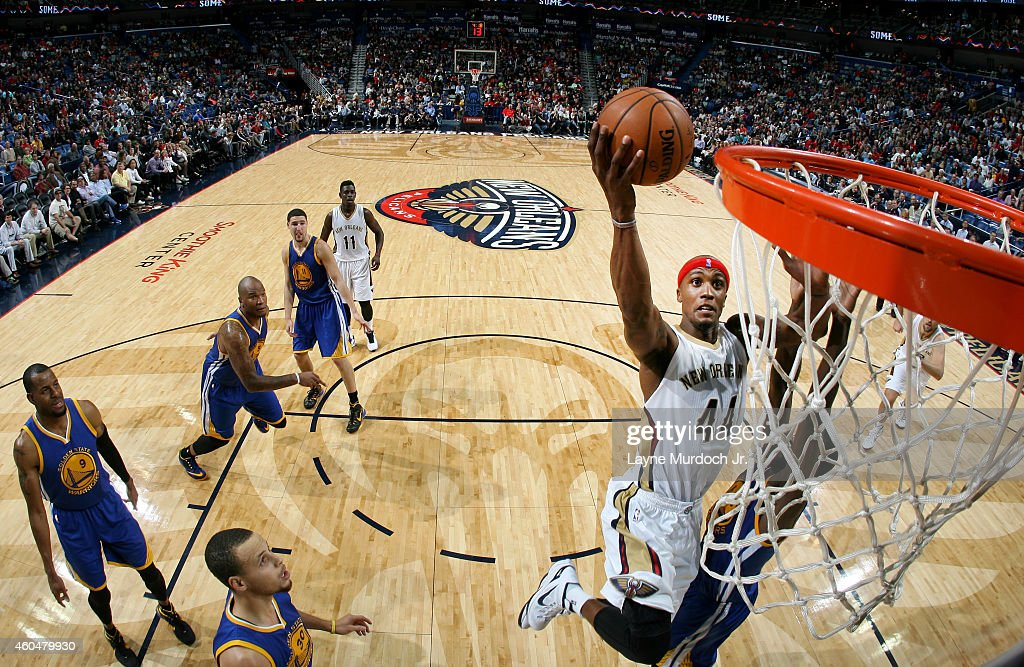 Dante Cunningham #44 of the New Orleans Pelicans goes for the dunk against the Golden State Warriors during an NBA game on December 14, 2014 at the Smoothie King Center in New Orleans, Louisiana.