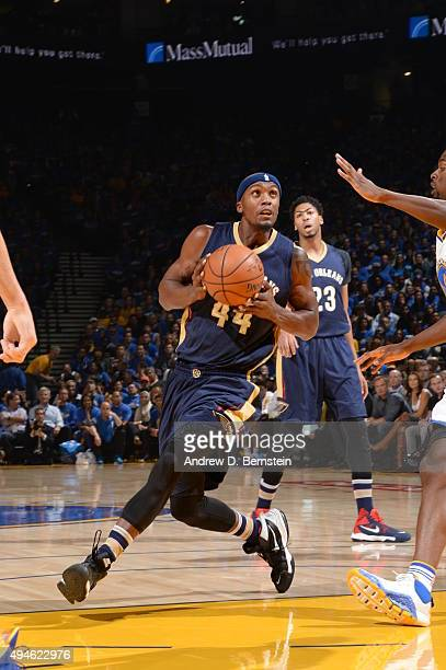 Dante Cunningham of the New Orleans Pelicans handles the ball against the Golden State Warriors on October 27 2015 at ORACLE Arena in Oakland...