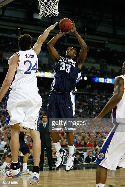 Dante Cunningham of the Villanova Wildcats attempts a shot against the Kansas Jayhawks during the Midwest Regional Semifinal of the 2008 NCAA...