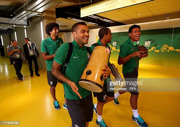 Dante Daniel Alves Lucas Moura and Paulinho of Brazil arrive at the stadium playing musical instrumenets prior to the FIFA Confederations Cup Brazil...