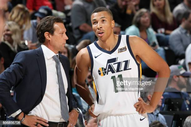 Dante Exum and Head Coach Quin Snyder of the Utah Jazz talk during a preseason game against the Sydney Kings on October 2 2017 at vivintSmartHome...