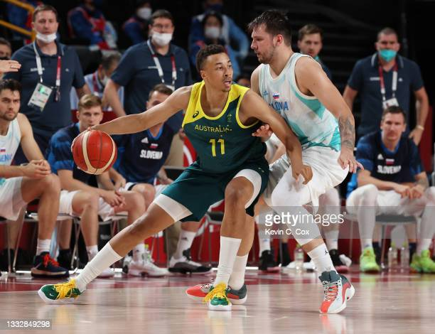 Dante Exum of Team Australia drives to the basket against Luka Doncic of Team Slovenia during the second half of the Men's Basketball Bronze medal...