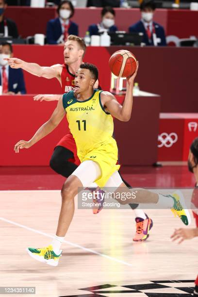 Dante Exum of the Australia Men's National Team drives to the basket during the game against the Germany Men's National Team during the 2020 Tokyo...