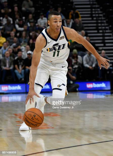 Dante Exum of the Utah Jazz brings the ball up court against the Sydney Kings at Vivint Smart Home Arena on October 2 2017 in Salt Lake City Utah...