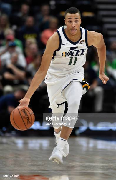Dante Exum of the Utah Jazz brings the ball up court against the Maccabi Haifa in preseason action at Vivint Smart Home Arena on October 4 2017 in...
