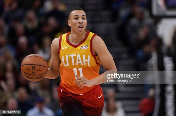 Dante Exum of the Utah Jazz brings the ball up court against the Golden State Warriors in the second half of a NBA game at Vivint Smart Home Arena on...